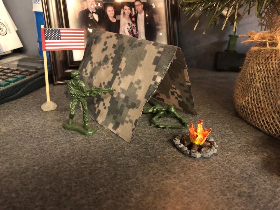 Military salute next to Christmas tree
