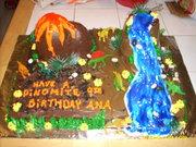 Volcano-dinosaur cake