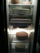Summer bash cake layers in refrigerator