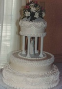 Wedding cake with royal frosting string work and real flowers topper