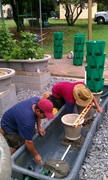 Installing the Plumbing, Bricks, and concrete Planter for the grow towers in the DWC tank 1