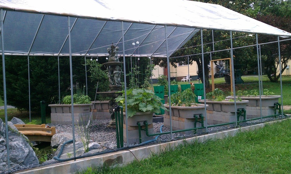 Side View of the 4 Media beds, New grow towers and pond