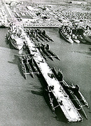 USS Orion with 15 subs in port.