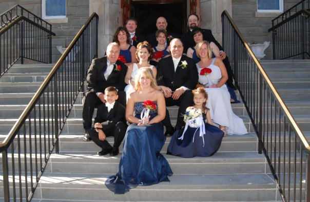 bridal party on steps of church