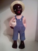 black boy w/chicken pottery figurine