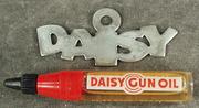 Vintage Daisy Gun Plastic Oiler and Metal Daisy Hang Tag