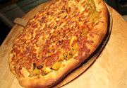 Squash, bacon, onion pizza