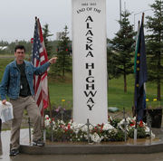 Randy poses at Official End of Alaska Highway during scout