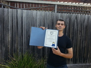 Adam with his certificate
