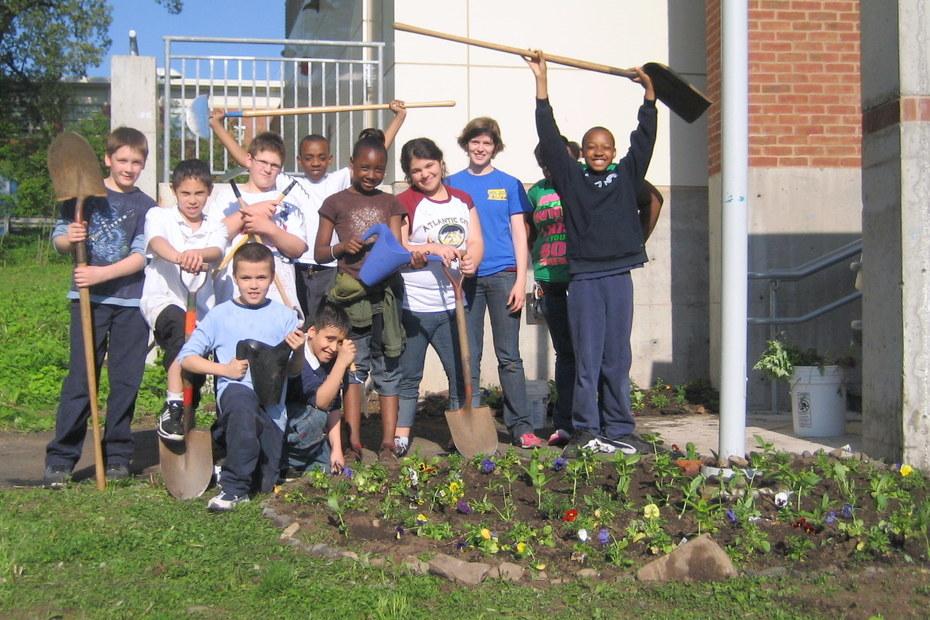 Solar Youth Stewards planting flowers