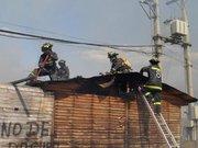8a. Cía. de Bomberos de Santiago sobre un techo