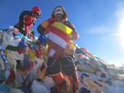 A Climber Who Raised The Pictures Of Buddha, Dalai Lama, And Obama On The Top Of Mt. Everest