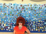 Ann travels the world-showing  off some of travel magnet board-all places I have been/experienced