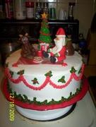 Santa & Rudolph having sugar cookies