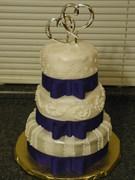Blue bow wedding cake