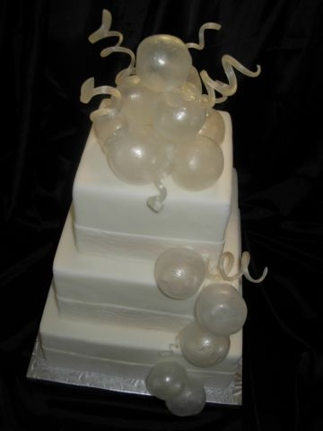 Blown Sugar Bubbles and Curls on a Pearl Dusted White Wedding Cake