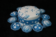 blue and white cake and cupcakes