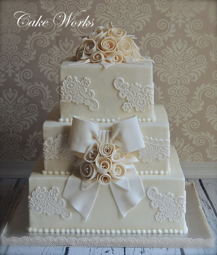 Vintage lace and ribbon rose wedding cake