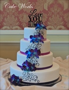 Ombre purple with blue orchids wedding cake