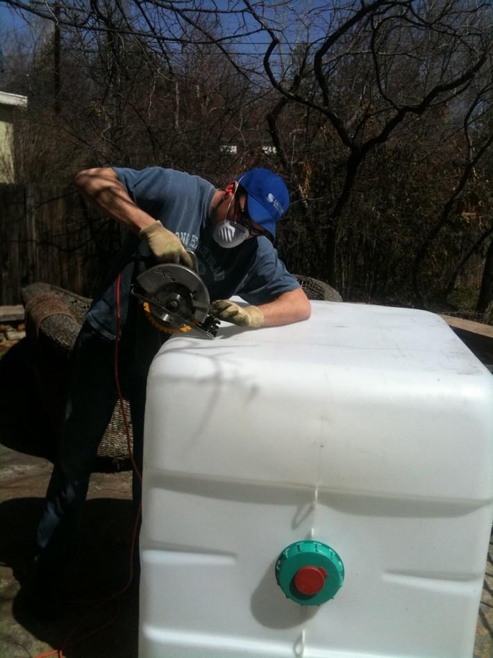 JD cutting the 275 gallon IBC tote