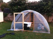 Greenhouse with the door and covering finished
