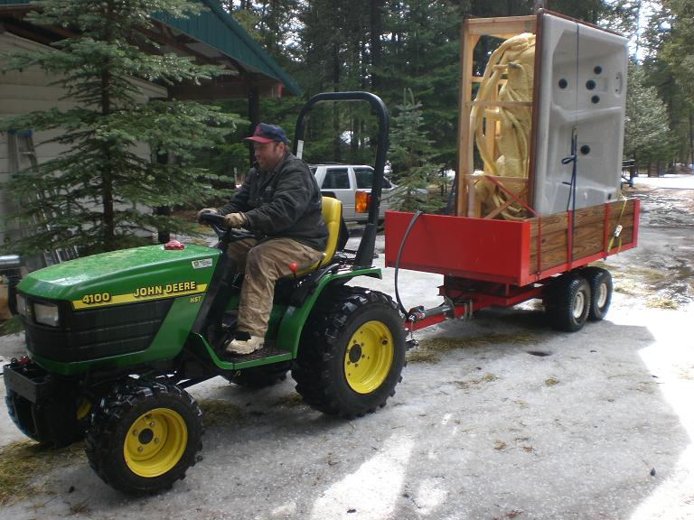 A man, a tractor, and a hot tub. What else is there?