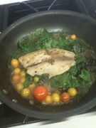 This is Tilapia steamed on a bed of Kale with garden tomatoes.