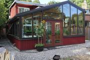 Greenhouse solarium housing aquaponics system