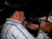 kolt signing autographs