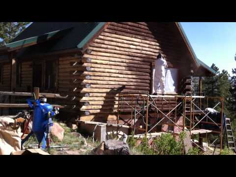 Media Blasting a Log Cabin with Corn Cob to remove old finish