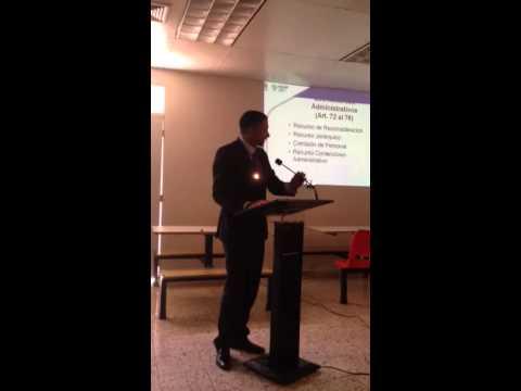 Geovanny Vicente Romero dictando charla en la UASD
