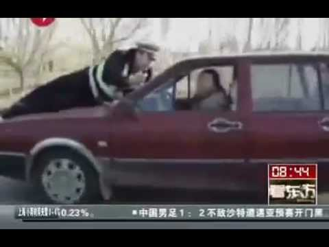 Woman Drives Off With Cop on The Hood of Car!!!