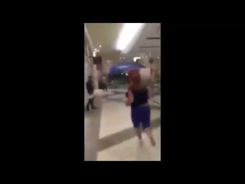 Lady Caught Stealing At Mall, Escapes Mall Cops And Then Runs Away In Slow Motion