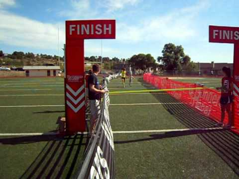 Cody Hill and daughter, Sydney, cross the finishline in first place at the 2011 Max Silver Fun Run