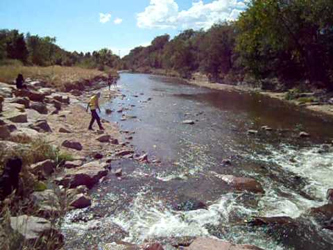 Top runners splash through Monument Creek in the Pikes Peak Road Runners' Fall Series