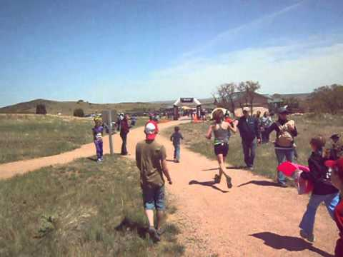 Connilee Walter gets an escort to finish of the 50K Cheyenne Mountain Trail Race