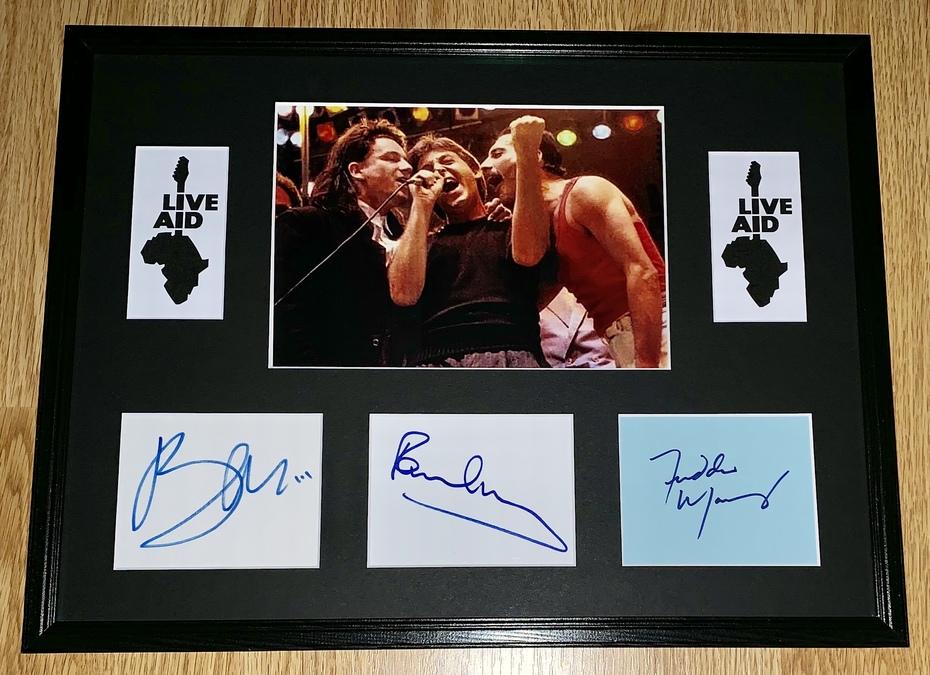 My Live Aid display, autographs by Freddie Mercury, Paul McCartney & Bono