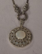MMarcasite pin with arr deco design and chain