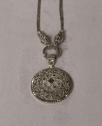 MMarcasite pin with art deco design and 18 chain