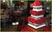 huge black and white cake   with red flowers