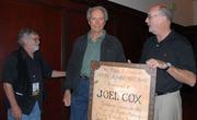 Clint Eastwood give Joel Cox award