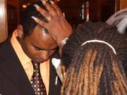 Apostle laying hands on Pastor D.K. Robinson