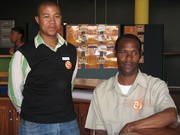 Andile Njamela and Father Mudau with their Open Access buttons
