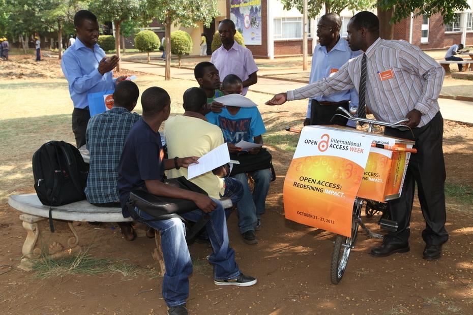 Mr Mujera Distributes Promo Materials while Mr Nhakura Explains to group of students