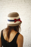 Camel cloche with cream,navy and red ribbon