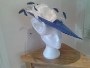 Regal Blue Hatinator with Satin Flowers & Feathers