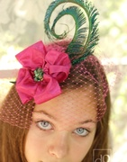 Pink Fascinator with Peacock Feathers