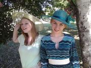 Sheree wearing mint hat, Madi in teal.