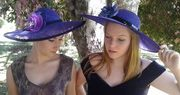 Madi and Sheree in purple hats.