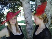 Sheree and Madi in red hats.